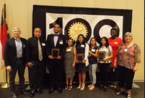 Adam Eigenrauch, Executive Director, Emily K Center (left), Troy Weaver, Kahlik Weaver (Durham Rotary Centennial Scholar), Florentina Gonzalez, Pamela Gonzalez (Brown Family Scholarship recipient), Blanca Velazquez, Brenda Duran Velazquez (Durham Rotary Centennial Scholar), Alexandra Zagayou, Executive Director Student U, and Meg Solera, Co-Chair Scholarship Committee, Durham Rotary Club